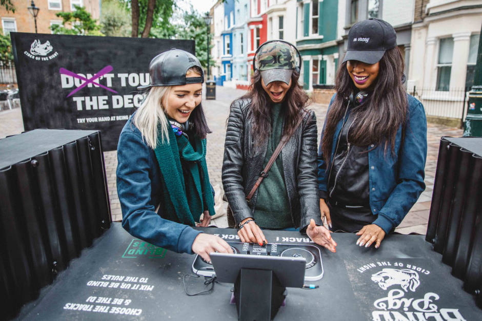 A passer by gets hands on with a new free pop-up in London's Portobello Road which is offering anyone who fancies a go the chance to try out DJ-ing on professional quality decks and free one-on-one lessons. The decks have been set up by Blind Pig Cider, inviting people to rethink the unwritten rules that stop us exploring and enjoying the world around us, this time using the example of DJ-ing; arguably one of the most exclusive musical instruments on hand.