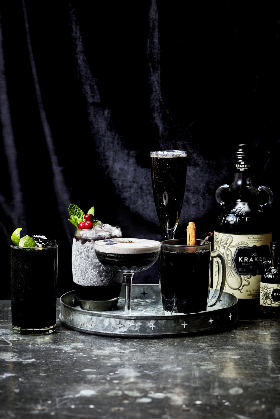 Cocktails (from left to right), Kraken Inky Winter Storm, Kraken Midnight Frost, Kraken Black Blitzen, Kraken's Little Helper and the hot, mulled Kraken It's Cold Outside feature at Kraken Black Christmas, new pop-up Christmas experience launching this December, promises a mouth-watering dark twist on the ideal festive meal.. the world's first ever all-black Christmas feast. For further information please contact Cow PR on 020 7234 9150 or kraken@cowpr.com PR Handout - free for editorial usage.