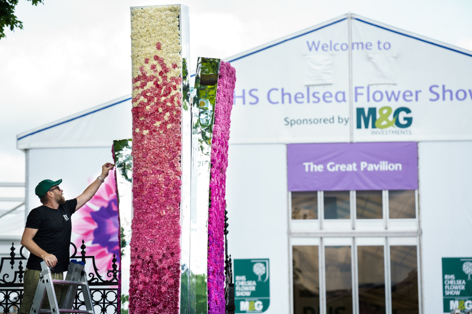 Robert Hornsby, Florist and Installation Designer from In Water Flowers places the final carnation to 'Neoteric' the design for the Bull Ring Gate at Chelsea Flower Show