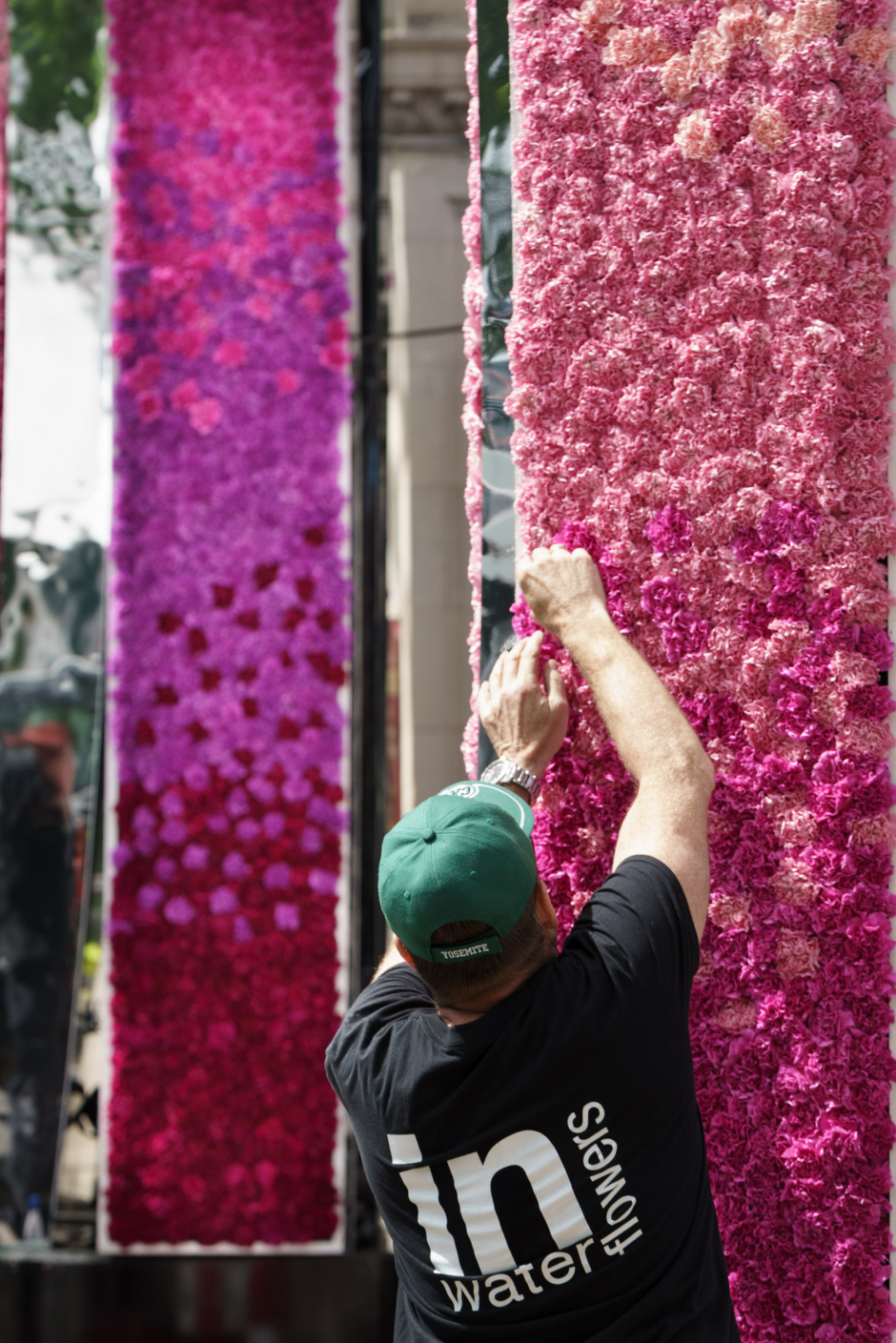 Robert Hornsby, Florist and Installation Designer from In Water Flowers puts the finishing touches to 'Neoteric' the design for the Bull Ring Gate at Chelsea Flower Show