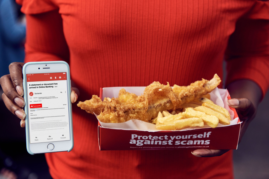 To raise awareness of the number of phishing scams happening in the UK, Santander has launched 'Phish & Chips': a unique fish and chips van that only accepts payment in the form of phishing emails and smishing texts. Customers at Santander's new Phish & Chips van can simply present staff with a phishing email or smishing text they have received from scammers as currency to exchange for a portion of fish and chips (along with a side of advice on avoiding the tricks criminals use in their attempts to steal people's money and identities). This picture: a member of the public shows the phishing email, sent by a scammer, that they used to buy a portion of fish and chips.