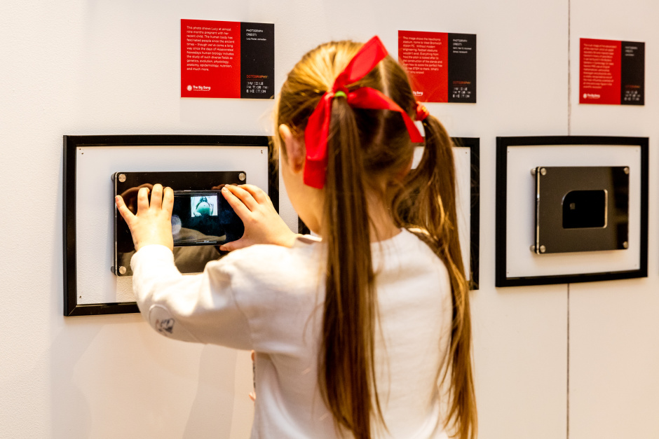 "Visitors attend world's first ""invisible"" photography exhibition - featuring images so small that they require a microscope to be seen. Entitled ""Dotography"", the exhibition was organised by The Big Bang Fair 2018 to raise awareness of the largest celebration of STEM for young people in the UK. The collection includes famous images of scientific importance and original photos submitted by celebrities, the STEM community and local school children. Dotography runs until 28th January at the Birmingham Bullring Link Street, Unit K2."